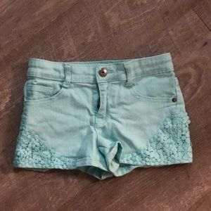 Girls crazy 8 shorts. Mint green in color